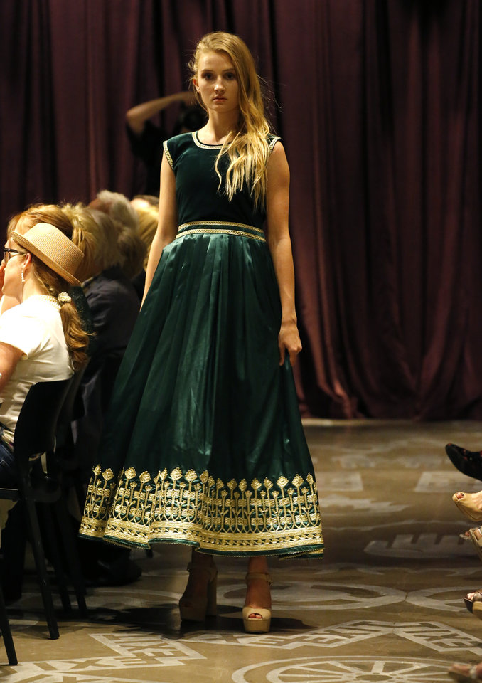 Photo -  Afghani designer Shadia Muhamedi's incorporates rich color, embellishments and feminine structure in her garments. [PHOTO BY BRYAN TERRY, THE OKLAHOMAN]