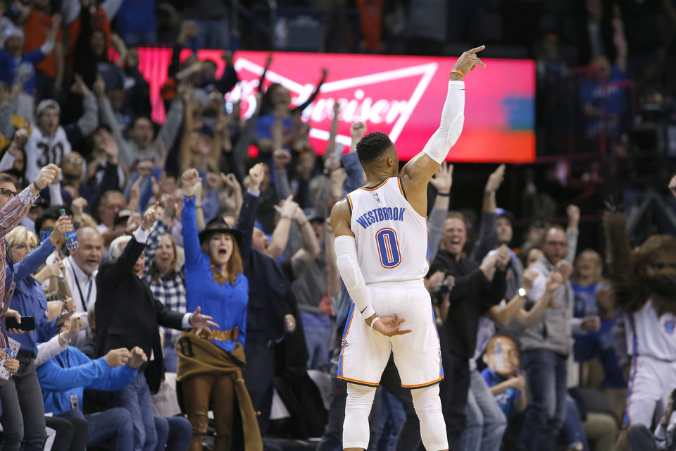 Photo - Oklahoma City's Russell Westbrook (0) hits a 3-point basket during the NBA game between the Oklahoma City Thunder and Minnesota Timberwolves at the Chesapeake Energy Arena, Tuesday, Jan. 8, 2019. Photo by Sarah Phipps, The Oklahoman