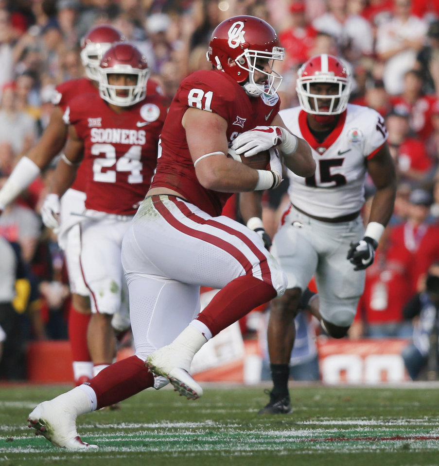 Photo - Oklahoma's Mark Andrews (81) runs after a catch during the Rose Bowl Game, a College Football Playoff Semifinal, between the Oklahoma Sooners (OU) and Georgia Bulldogs (UGA) at the Rose Bowl in Pasadena, California, Monday, Jan. 1, 2018. Photo by Nate Billings, The Oklahoman