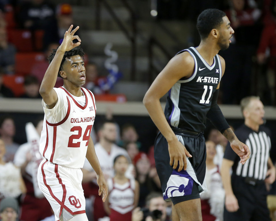 Photo - Oklahoma's Jamal Bieniemy (24) gestures beside Kansas State's Antonio Gordon (11)  after making a basket during an NCAA college basketball game between the University of Oklahoma Sooners (OU) and the Kansas State Wildcats at Lloyd Noble Center in Norman, Okla., Saturday, Jan. 4, 2020. [Bryan Terry/The Oklahoman]