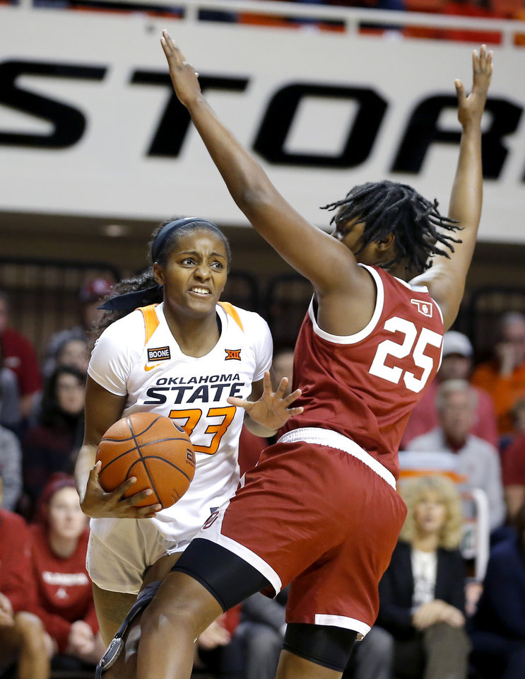 Photo - Oklahoma State's Clitan de Sousa (33) looks past Oklahoma's Madi Williams (25) during a women's Bedlam college basketball game between the Oklahoma State University Cowgirls (OSU) and the University of Oklahoma Sooners (OU) at Gallagher-Iba Arena in Stillwater, Okla., Wednesday, Jan. 8, 2020. [Bryan Terry/The Oklahoman]