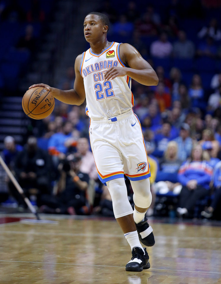 Photo - Oklahoma City's Devon Hall (22) dribbles the ball up court during the preseason NBA game between the Oklahoma City Thunder and the Dallas Mavericks at the BOK Center in Tulsa, Okla. , Tuesday, Oct. 8, 2019. [Sarah Phipps/The Oklahoman]