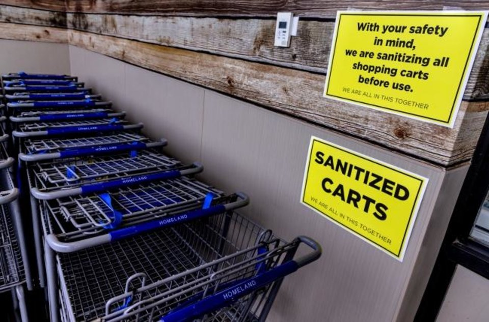 Photo -  Sanitized carts are provided to customers at Homeland at 1108 NW 18. [CHRIS LANDSBERGER/THE OKLAHOMAN]