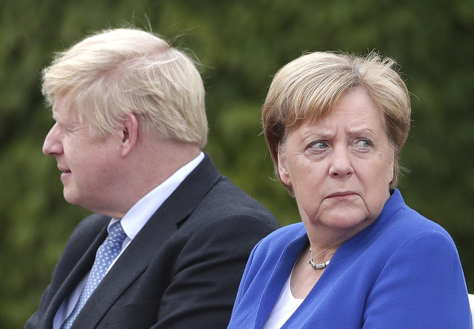 Photo -  German Chancellor Angela Merkel welcomes Britain's Prime Minister Boris Johnson for a meeting at the Chancellery in Berlin, Germany, Wednesday, Aug. 21, 2019. (AP Photo/Michael Sohn)