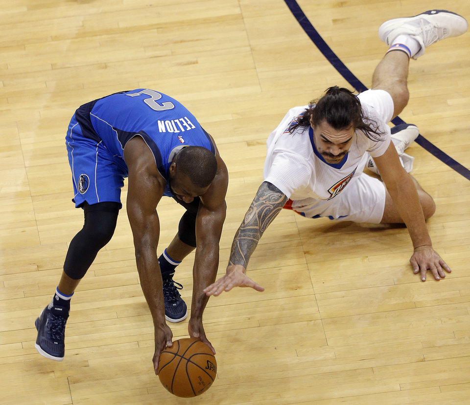 Photo - Oklahoma City's Steven Adams (12) and Dallas' Raymond Felton (2) scramble for a loose ball during Game 2 in the first round of the NBA playoffs between the Oklahoma City Thunder and the Dallas Mavericks at Chesapeake Energy Arena in Oklahoma City, Monday, April 18, 2016. Photo by Sarah Phipps, The Oklahoman