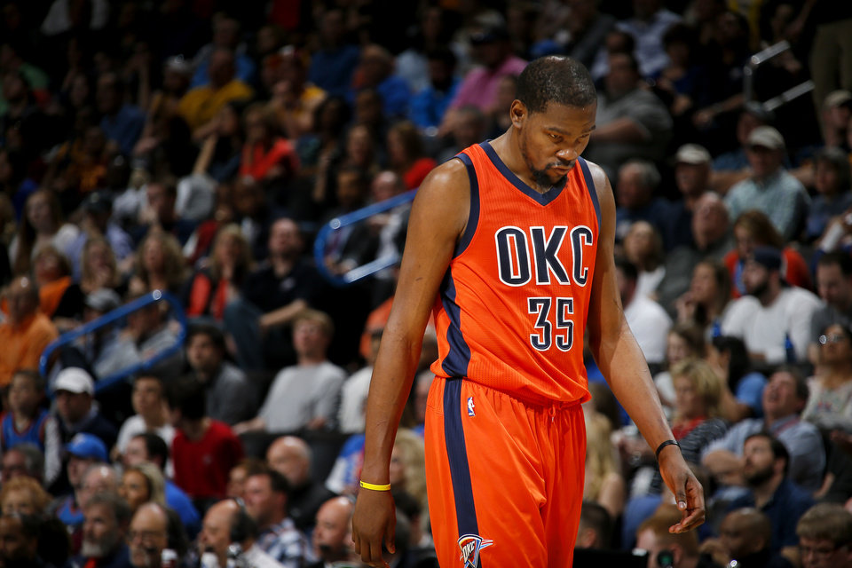 Photo - Oklahoma City's Kevin Durant (35) walks back to the bench during an NBA basketball game between the Oklahoma City Thunder and the Cleveland Cavaliers at Chesapeake Energy Arena in Oklahoma City, Sunday, Feb. 21, 2016. Oklahoma City lost 115-92.  Photo by Bryan Terry, The Oklahoman