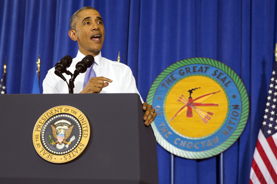 Photo - President Barack Obama speaks in the Choctaw Nation on economic opportunities for underprivileged communities across the nation, on Wednesday, July 15, 2015, in Durant, Okla. (AP Photo/Evan Vucci)