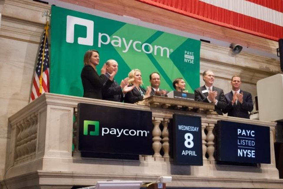 Photo -  Paycom executives at the New York Stock Exchange. [PROVIDED]
