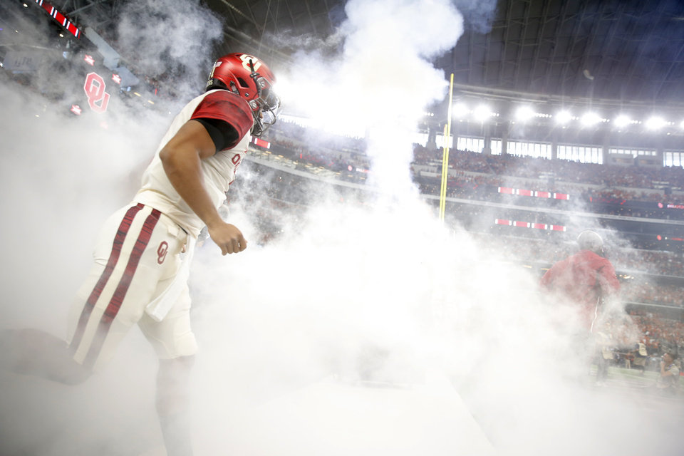 Photo - Oklahoma's Kyler Murray takes the field before the Big 12 Championship football game between the Oklahoma Sooners (OU) and the Texas Longhorns (UT) at AT&T Stadium in Arlington, Texas, Saturday, Dec. 1, 2018.  Oklahoma won 39-27. Photo by Bryan Terry, The Oklahoman