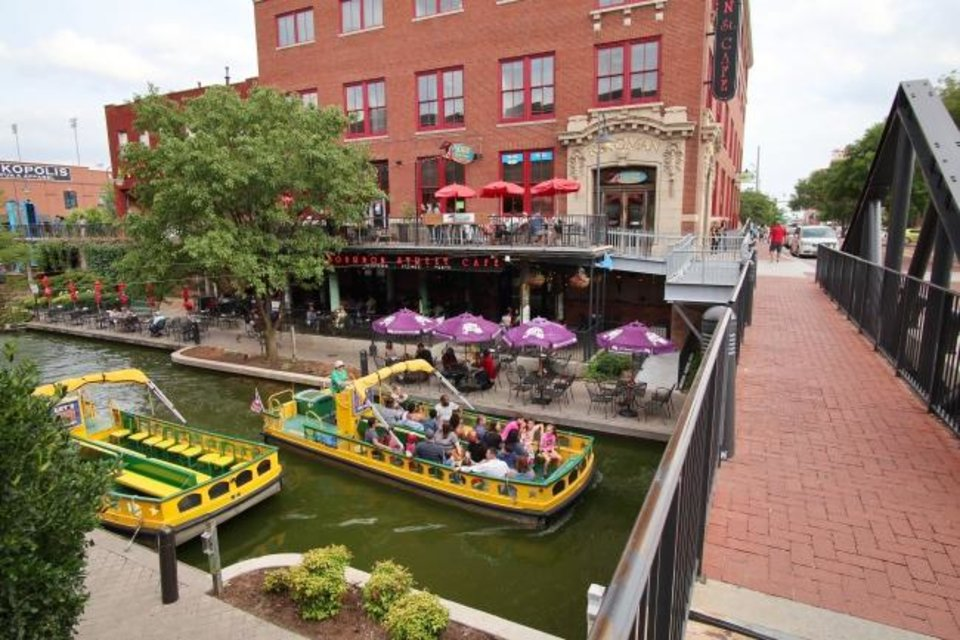 Photo -  Annual ridership on the Bricktown Water Taxis has topped 100,000 a year since Bob Bekoff took a gamble on starting up the operation on a mostly undeveloped Bricktown Canal. The late Bekoff's family sold the operation to longtime manager Chad Huntington on Wednesday. [DOUG HOKE/THE OKLAHOMAN}