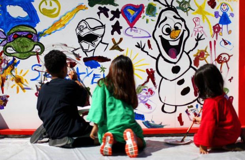 Photo - Children paint a mural during the 2014 Plaza District Festival in Oklahoma City. Photo by Bryan Terry, The Oklahoman Archives