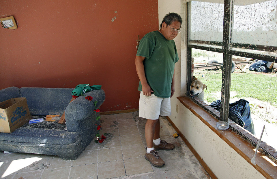 Photo - Robert Todd looks out the window of his house destroyed by a tornado on Tuesday west of El Reno, Wednesday, May 25, 2011. Photo by Chris Landsberger, The Oklahoman