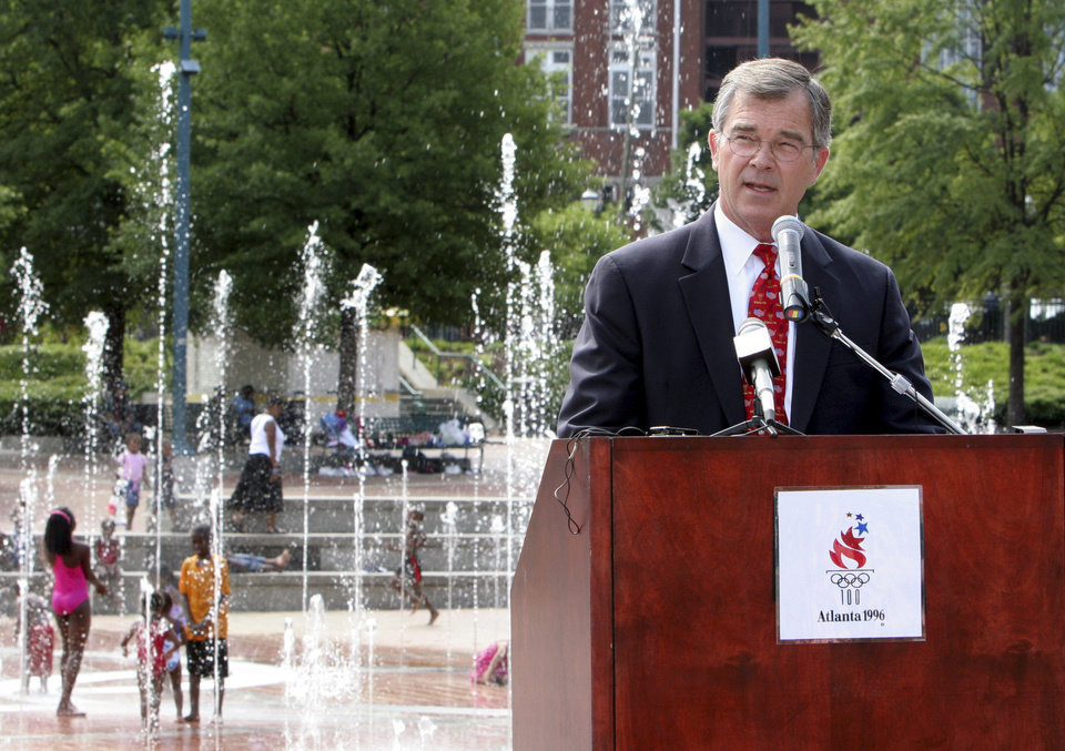 Photo - **ADVANCE FOR WEEKEND EDITIONS, JULY 14-15 - FILE** Billy Payne, who spearheaded Atlanta's successful bid to host the 1996 Summer Olympics, speaks during a press conference June 19, 2006, at Centennial Olympic Park in downtown Atlanta. Payne, as well as Republican presidential hopeful former Massachusetts Gov. Mitt Romney, who helped rescue the scandal-plagued 2002 Winter Games in Salt Lake City, and Peter Ueberroth, who ran the first profitable Olympics in Los Angeles in 1984 and is chairman of the U.S. Olympic Committee, have all offered advice to Chicago officials on what they need to do to win the 2016 Olympics and host a successful Games. Their advice was simple: Make friends on the International Olympic Committee. Train lots of volunteers. And don't do it for the money. (AP Photo/Gene Blythe) ORG XMIT: CX308
