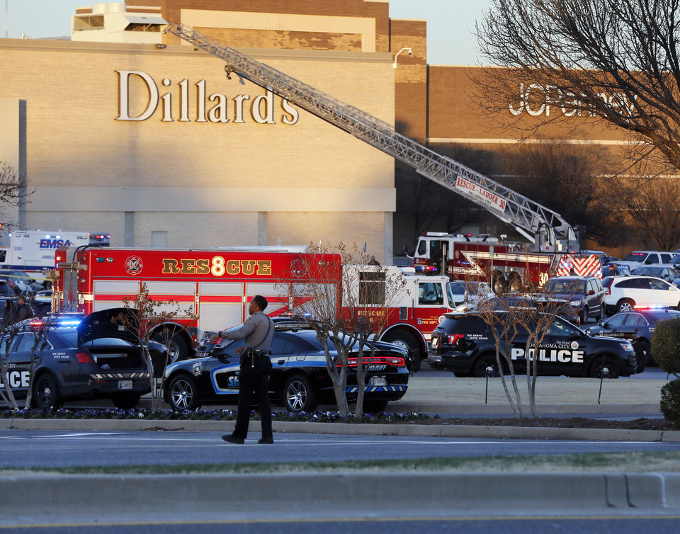 Photo - First responders work the scene after a shooting at Penn Square Mall in Oklahoma City, Thursday, Dec. 19, 2019. [Nate Billings/The Oklahoman]