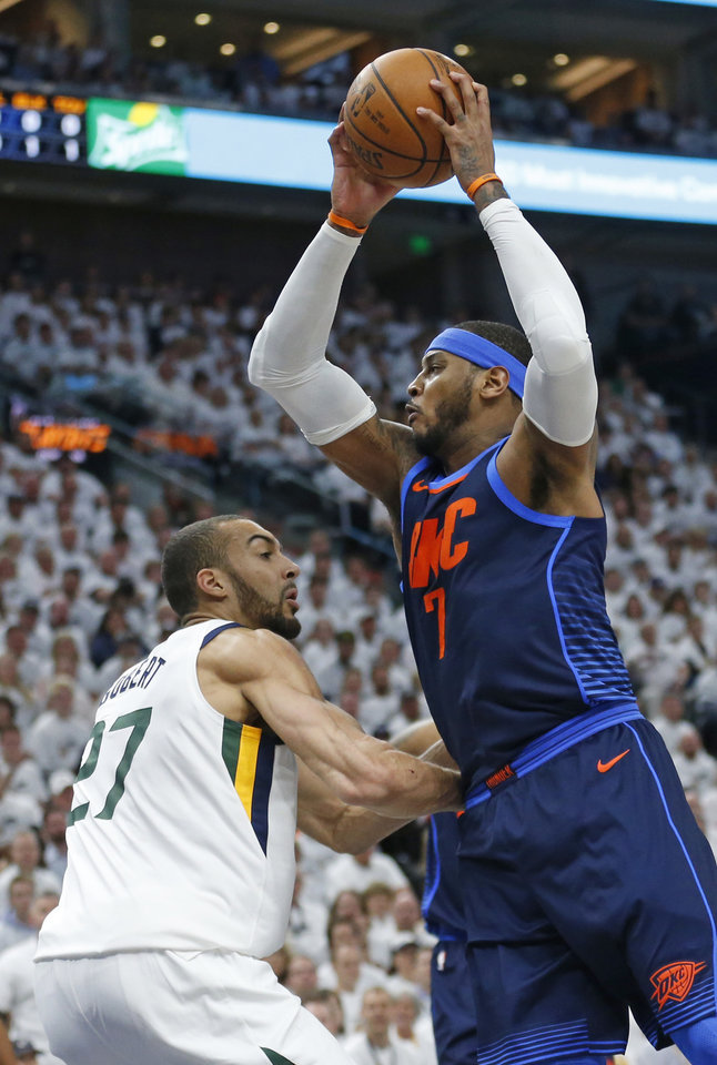Photo - Oklahoma City Thunder forward Carmelo Anthony (7) goes to the basket as Utah Jazz center Rudy Gobert (27) defends in the first half during Game 4 of an NBA basketball first-round playoff series Monday, April 23, 2018, in Salt Lake City. (AP Photo/Rick Bowmer)