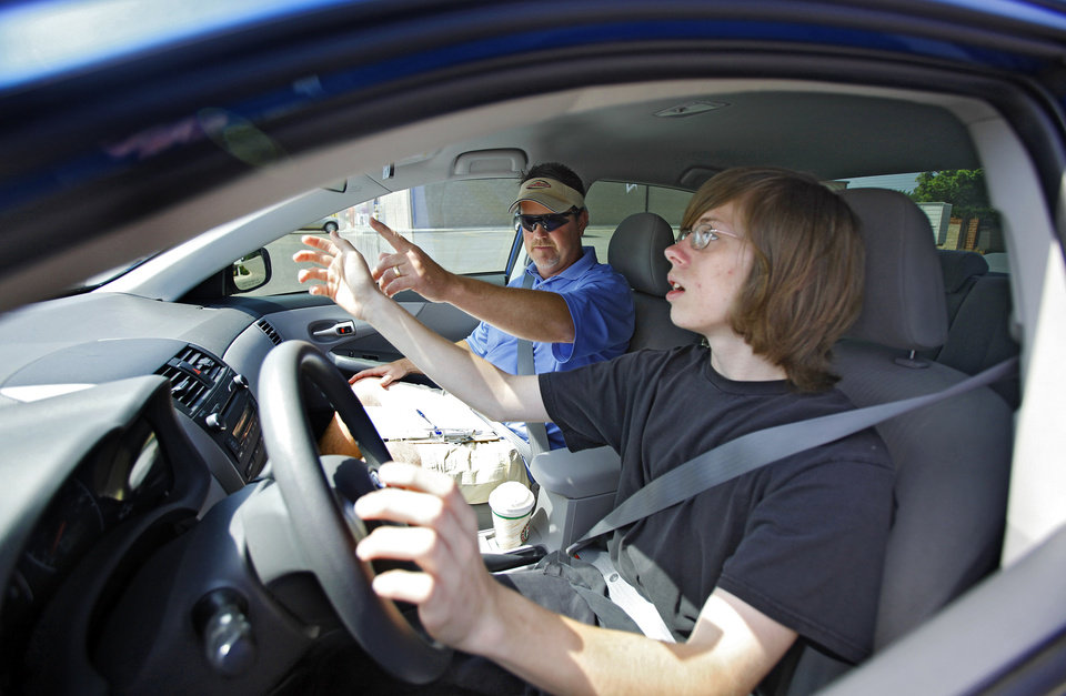 Photo - STUDENT DRIVER: Driving instructor Tony Borum works with driving student Brandon Glad while going though a pre-driving checklist at Brown's Driving School on Thursday, June 3, 2010, in Oklahoma City, Okla.   Photo by Chris Landsberger, The Oklahoman ORG XMIT: kod