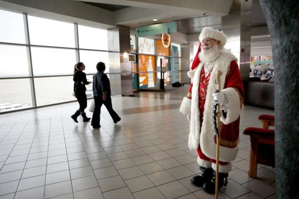 Photo -  Santa Claus greets travelers inside Will Rogers World Airport in 2018. [THE OKLAHOMAN ARCHIVES]