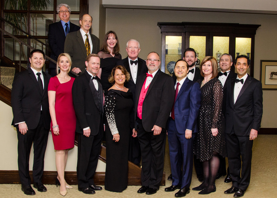 Photo - Dr. Robert Salinas, Dr. Christopher Jordan, Dr. Amanda Levine, Dr. David Holden, Dr. Chad Smith, back; Dr. Matthew Jared, Dr. Tabitha Danley, Dr. Jeffrey Cruzan, Dr. Lisa Wasemiller-Smith, Dr. R. Kevin Moore, Dr. Sam Dahr, Dr. Savannah Stumph, Dr. Basel Hassoun and Dr. Sumit Nanda, front:  2019 OCMS Board of Directors. PHOTO BY JOHN DOUGLAS