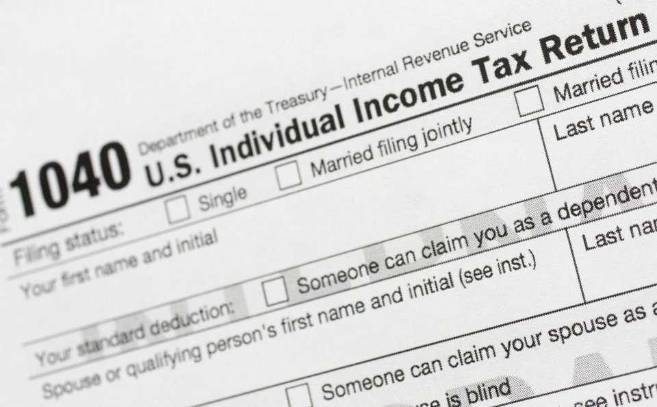 Photo -  This July 24, 2018, file photo shows a portion of the 1040 U.S. Individual Income Tax Return form. The Trump administration is working on plans to delay the April 15 federal tax deadline for most individual taxpayers as well as small businesses. Treasury Secretary Steven Mnuchin told Congress on Wednesday, March 11, 2020, that the administration is
