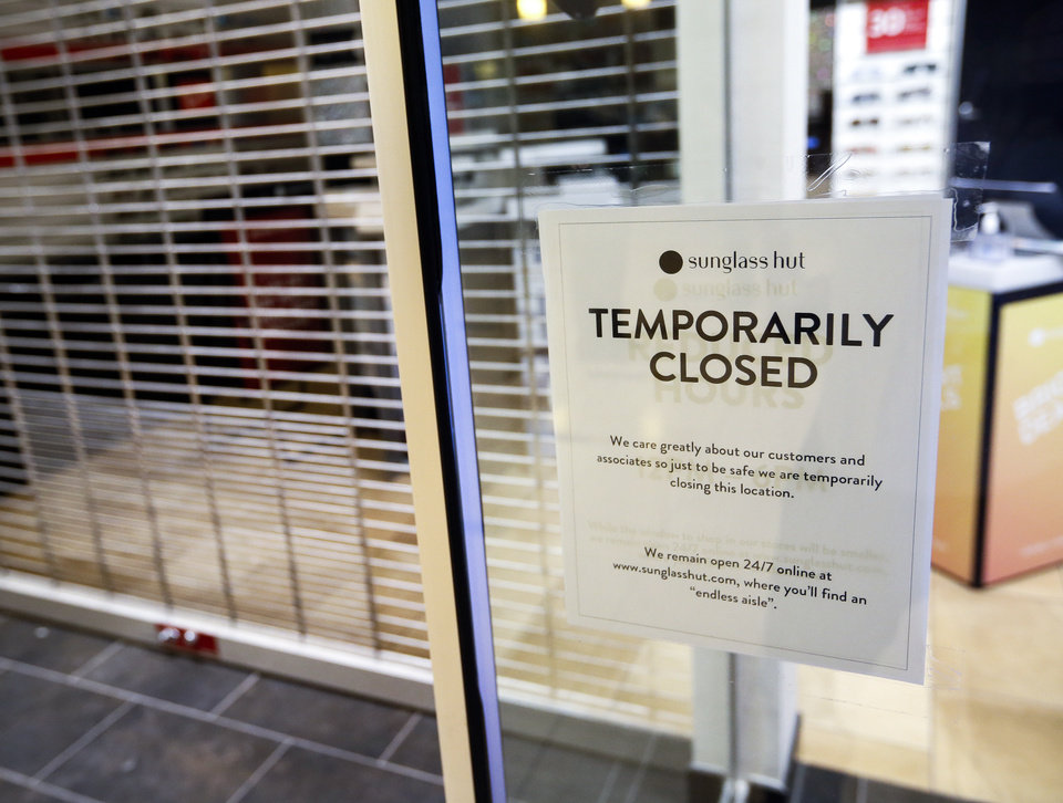 Photo - The Sunglass Hut is one of the businesses still closed at Penn Square Mall during the re-opening of the mall after being closed because of the coronavirus pandemic, in Oklahoma City, Friday, May 1, 2020. [Nate Billings/The Oklahoman]