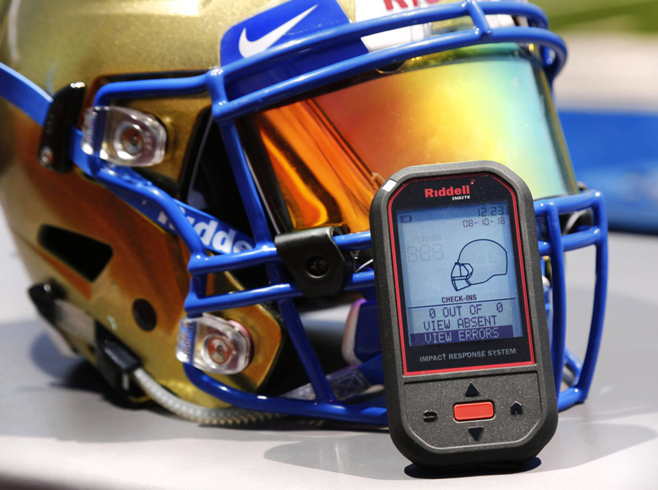 Photo -  The Choctaw High School football program has purchased more than 60 new Riddell SpeedFlex helmets lined with InSite technology. The helmets have sensors that will alert a hand-held device on the sideline when a powerful blow to the head is registered. [PHOTO BY JIM BECKEL, The Oklahoman]