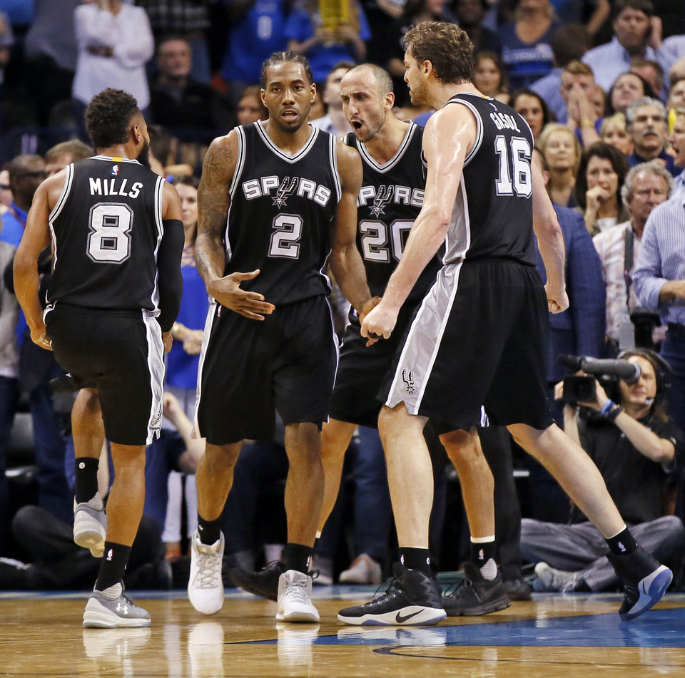 Photo - From left, San Antonio's Patty Mills (8), Kawhi Leonard (2), Manu Ginobili (20) ans Pau Gasol (16) celebrate after Leonard made a shot and was fouled late in the fourth quarter of an NBA basketball game between the Oklahoma City Thunder and San Antonio Spurs at Chesapeake Energy Arena in Oklahoma City, Friday, March 31, 2017. San Antonio won 100-95. Photo by Nate Billings, The Oklahoman