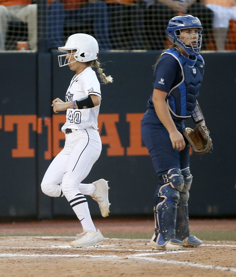 Photo - Oklahoma State's Shalee Brantley (40) scores past BYU's Libby Sugg (21) in the second inning of the Stillwater Regional NCAA softball tournament game between Oklahoma State (OSU) and BYU in Stillwater, Okla., Thursday, May 16, 2019. Oklahoma State won 3-1. [Bryan Terry/The Oklahoman]