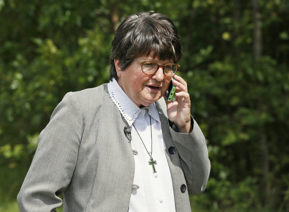 Photo - Sister Helen Prejean talks on the phone with Susan Sarandon after a two-week stay of execution was announced for Richard Eugene Glossip, outside the Oklahoma State Penitentiary in McAlester, Okla., Wednesday, Sept. 16, 2015. Prejean and Sarandon are advocates for Glossip's innocence. Photo by Nate Billings, The Oklahoman
