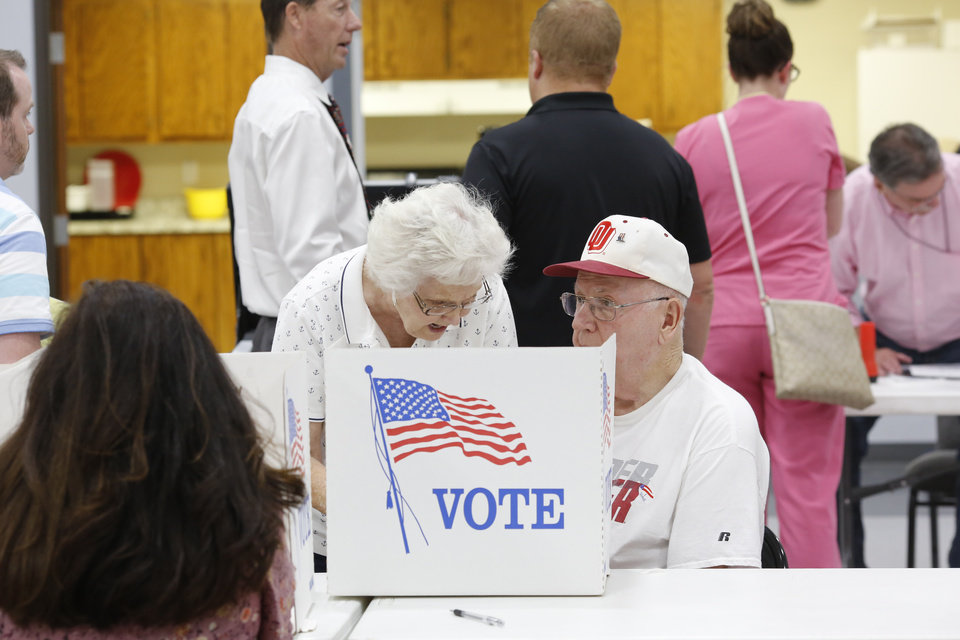 "Photo - Voters in precincts 97 and 98 shared voting booth space inside the Midwest City Community Church of the Nazarene near SE 15 and Post Rd during primary election voting on Tuesday, June 26, 2018.  An election worker at the site described voter turnout as ""heavy,'""  saying that lines of voters waiting to cast their ballots were at least 12-20 deep most of the day, and at times, the line extended out the door and into the parking lot.  Photo by Jim Beckel, The Oklahoman"
