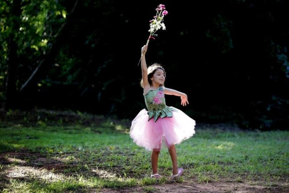 Photo -  Kaya Hamann, 6, dances on Saturday during the ball.