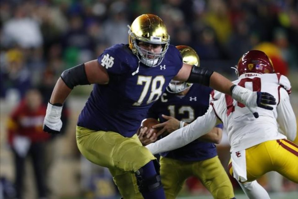 Photo -  Notre Dame offensive lineman Tommy Kraemer (78) blocks against Southern Cal in their game last October. [AP Photo/Paul Sancya]
