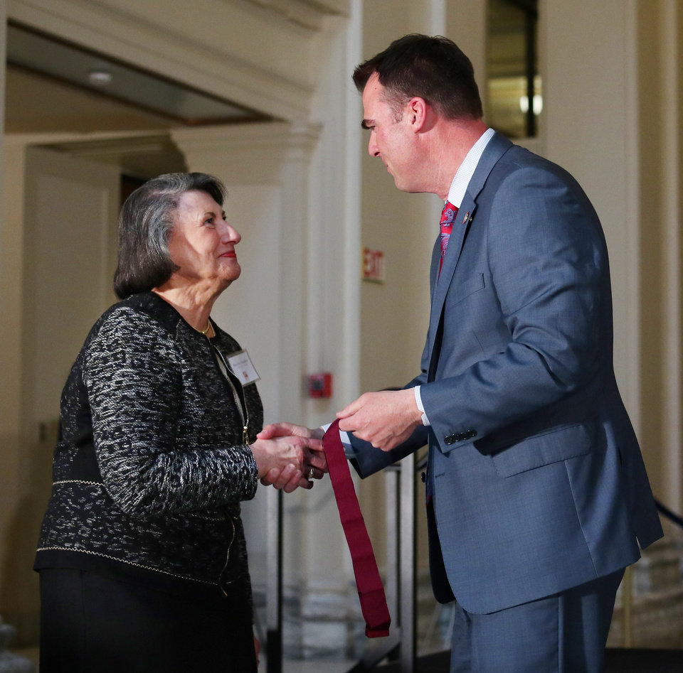 Photo - Mary Ann Hawkins receives a Community Award from Governor Kevin Stitt at the Governor's Arts Awards at the Capitol, Tuesday, April 16, 2019. Photo by Doug Hoke/The Oklahoman