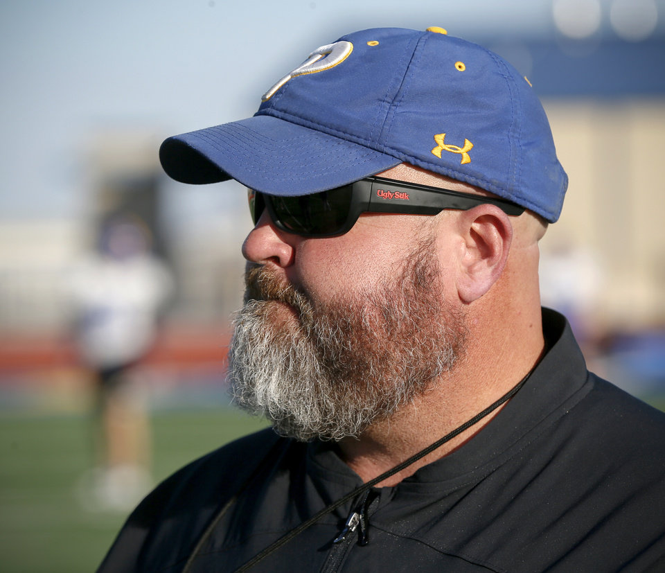 Photo - Piedmont head coach Jeff Hall watches his team practice at the Piedmont High School football stadium in Piedmont, Okla., Tuesday, Nov. 26, 2019. [Nate Billings/The Oklahoman]
