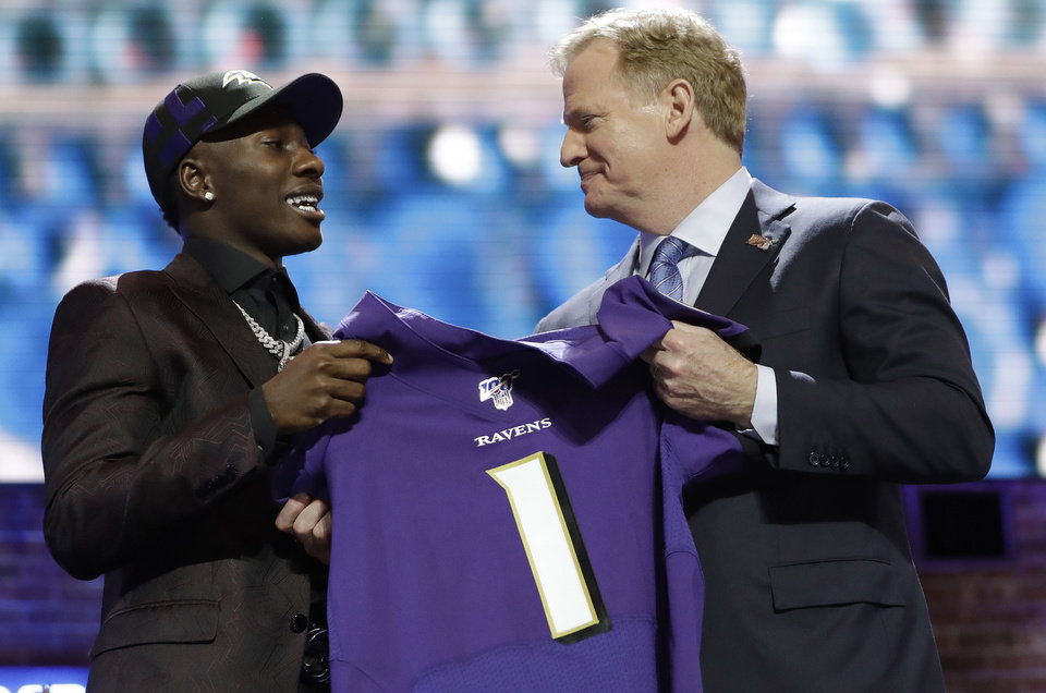 Photo - Oklahoma wide receiver Marquise Brown poses with NFL Commissioner Roger Goodell after the Baltimore Ravens Brown selected in the first round at the NFL football draft, Thursday, April 25, 2019, in Nashville, Tenn. (AP Photo/Mark Humphrey)