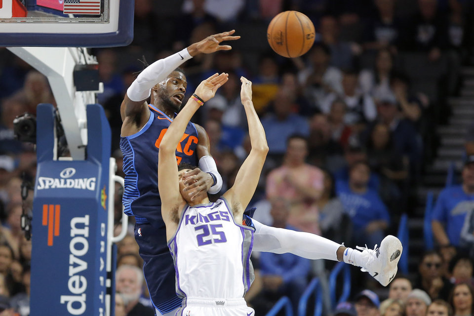 Photo - Oklahoma City's Nerlens Noel (3) reaches for the ball over Sacramento's Justin Jackson (25) during an NBA basketball game between the Oklahoma City Thunder and the Sacramento Kings at Chesapeake Energy Arena in Oklahoma City, Sunday, Oct. 21, 2018. Photo by Bryan Terry, The Oklahoman