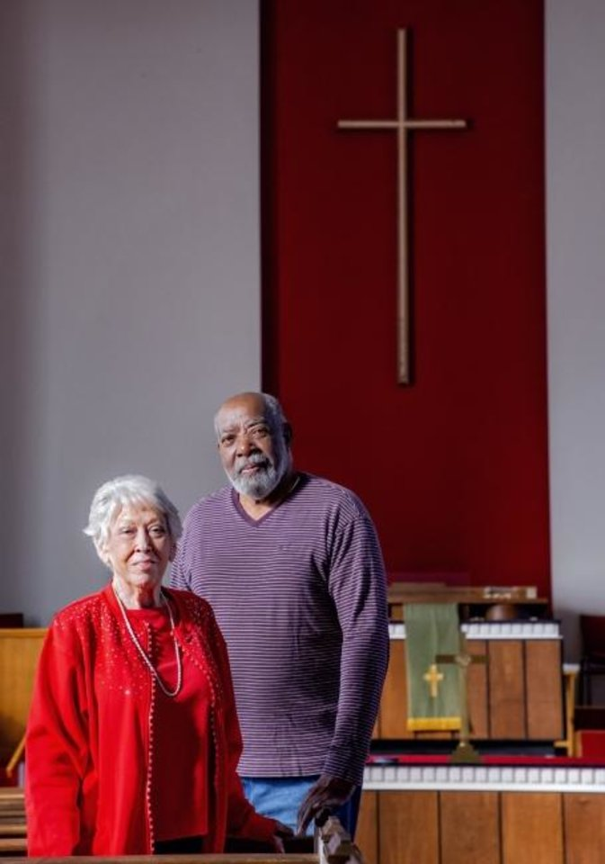 Photo -  Central Presbyterian Church elders Bobbie Heimbach and Willie Adams stand in the church's santuary where a final worship service will be held on Sunday at 5101 N May. The church building has been sold and is expected to be torn down. [Chris Landsberger/The Oklahoman]