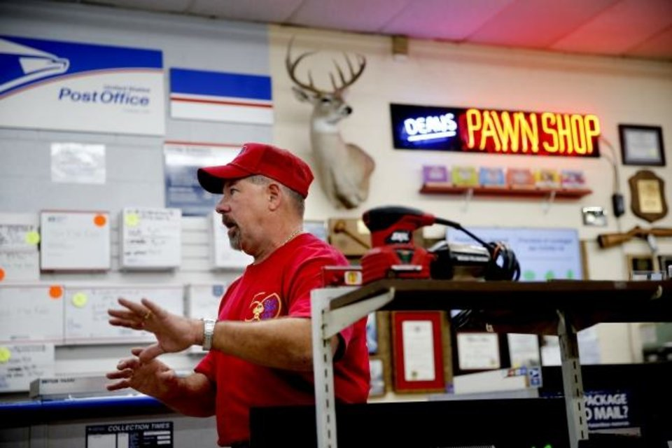Photo -  Dean's Drive-Thru Pawn Shop owner Brett Fisher talks about his pawn shop in Oklahoma City, Wednesday, April 22, 2020. [Bryan Terry/The Oklahoman]