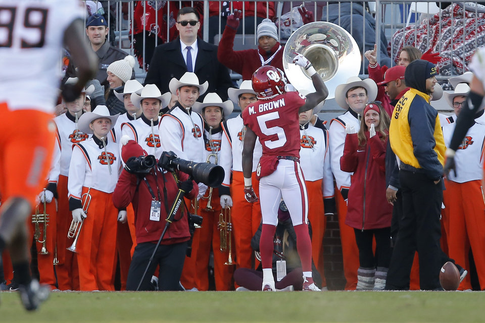 Photo - Oklahoma's Marquise Brown (5) celebrates after a touchdown during a Bedlam college football game between the University of Oklahoma Sooners (OU) and the Oklahoma State University Cowboys (OSU) at Gaylord Family-Oklahoma Memorial Stadium in Norman, Okla., Nov. 10, 2018.  Photo by Bryan Terry, The Oklahoman