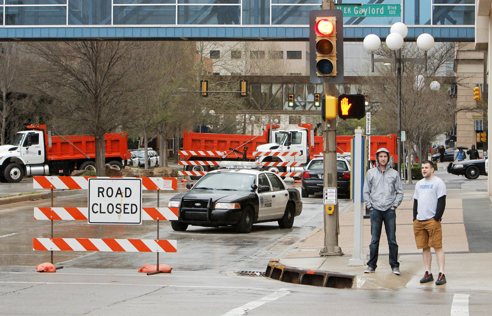 Photo - Police set up a roadblock Wednesday in Oklahoma City for security surrounding the president's visit. Photo by Doug Hoke, The Oklahoman