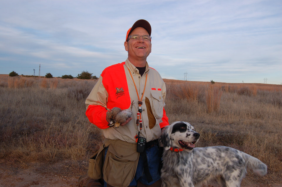 Photo -  James Dietsch of Oklahoma City and his friend's dog, Reagan, an English Setter, on the Cooper Wildlife Management Area last season. Dietsch will be chasing quail again this season in spite of the poor hunting outlook. [PHOTO PROVIDED]