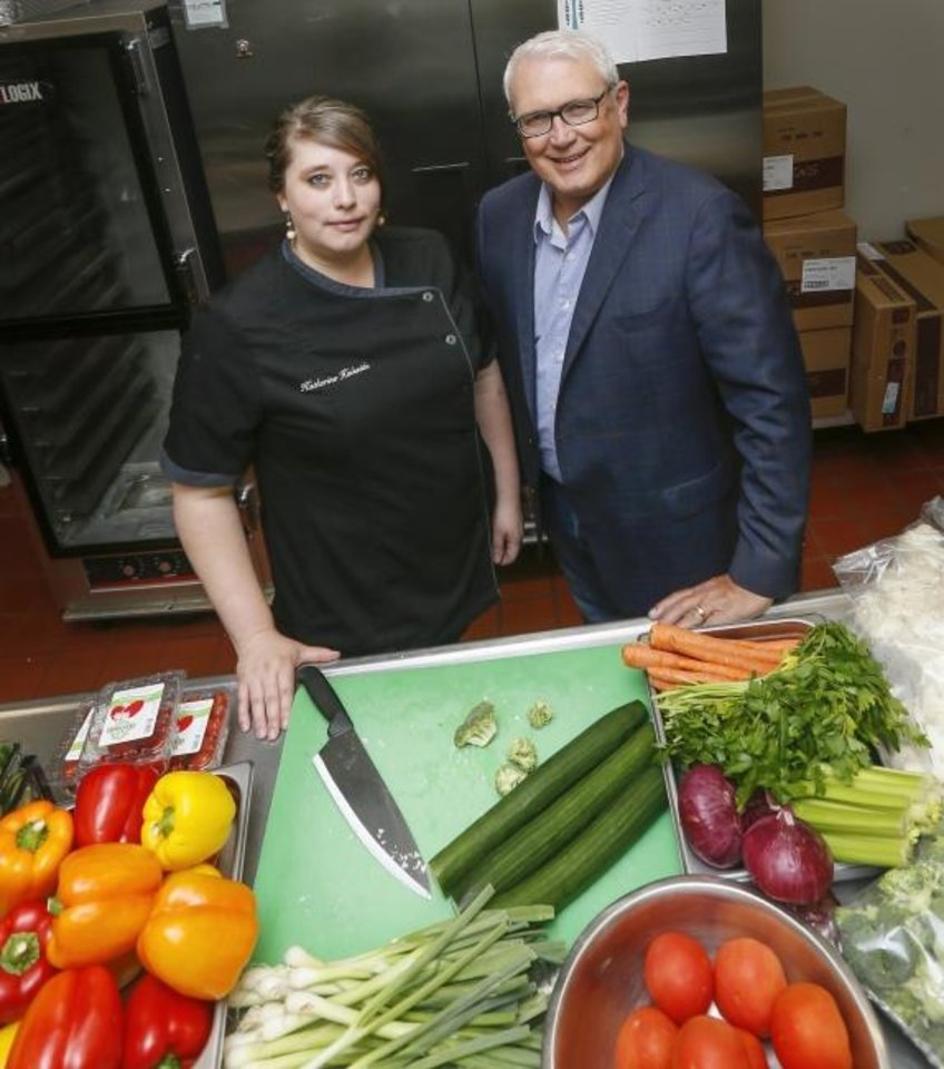 Photo -  Katherine Halseide, executive chef and director of catering at St. Luke's United Methodist Church, stands with Chris Lambert, director of St. Luke's Ending Hunger OKC, in the kitchen where church volunteers prepare Mobile Meals each week for home-bound older adults. [Nate Billings/The Oklahoman]