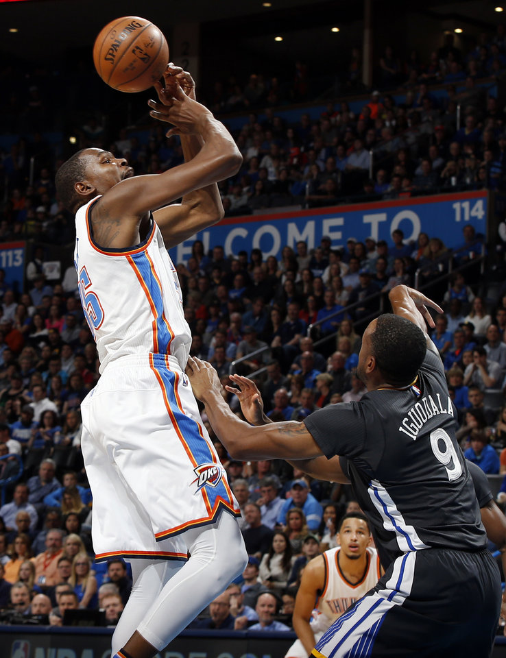 Photo - Oklahoma City's Kevin Durant (35) loses the ball as he is fouled by Golden State's Andre Iguodala (9) in the first half during an NBA basketball game between the Oklahoma City Thunder and the Golden State Warriors at Chesapeake Energy Arena in Oklahoma City, Saturday, Feb. 27, 2016. Photo by Nate Billings, The Oklahoman