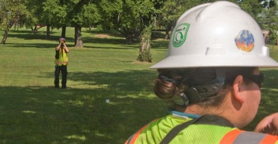 Photo -  Beals and Noelani Nomiyama, a consulting arborist, gather vegetation data from a tenth-acre plot on the grounds of the Oklahoma School of Science and Mathematics in Oklahoma City earlier this year. Their work was included as part of a survey Davey Resource Group conducted to measure the amount of tree coverage in the Oklahoma City area.