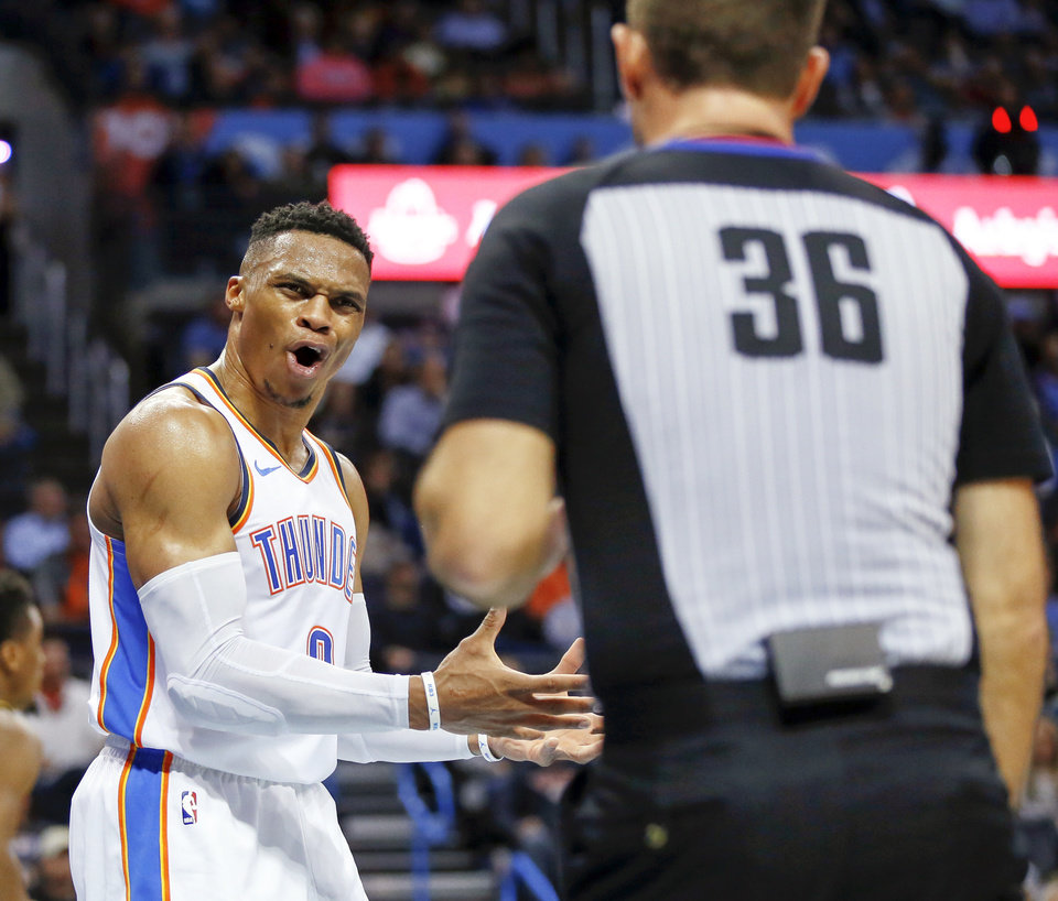 Photo - Oklahoma City's Russell Westbrook (0) questions official Brent Barnaky (36) after believing he was fouled on a play during an NBA basketball game between the Utah Jazz and the Oklahoma City Thunder at Chesapeake Energy Arena in Oklahoma City, Monday, Dec. 10, 2018. Oklahoma City won 122-113. Photo by Nate Billings, The Oklahoman