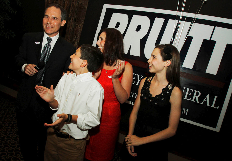 Photo - Republican candidate for Attorney General Scott Pruitt celebrates with his wife Marlyn, son Cade, 11, and daughter McKenna, 15, after winning the primary vote, taken at his watch party at the Cedar Ridge Country Club in Tulsa, Okla., on July 27,2010. JAMES GIBBARD/Tulsa World
