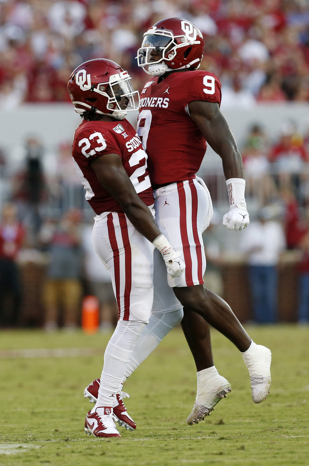 Photo - Oklahoma's Kenneth Murray (9) and DaShaun White (23) celebrate a sack by White in the second quarter during a college football game between the Oklahoma Sooners (OU) and South Dakota Coyotes at Gaylord Family - Oklahoma Memorial Stadium in Norman, Okla., Saturday, Sept. 7, 2019. [Nate Billings/The Oklahoman]