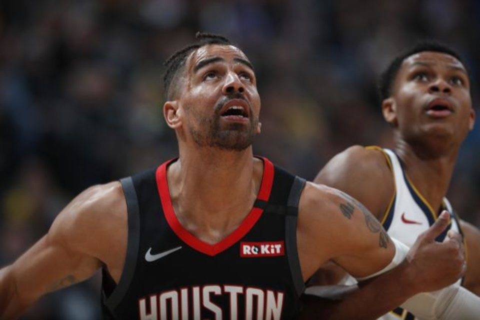 Photo -  FILE - In a Sunday, Jan. 26, 2020 file photo, Houston Rockets forward Thabo Sefolosha (18), left, and Denver Nuggets guard PJ Dozier (35) in the second half of an NBA basketball game, in Denver. Time has not healed all wounds for Sefolosha, the NBA veteran who says he was attacked by a group of New York Police Department officers in April 2015 while they were arresting him outside a nightclub in the city's Chelsea neighborhood.  (AP Photo/David Zalubowski, File)