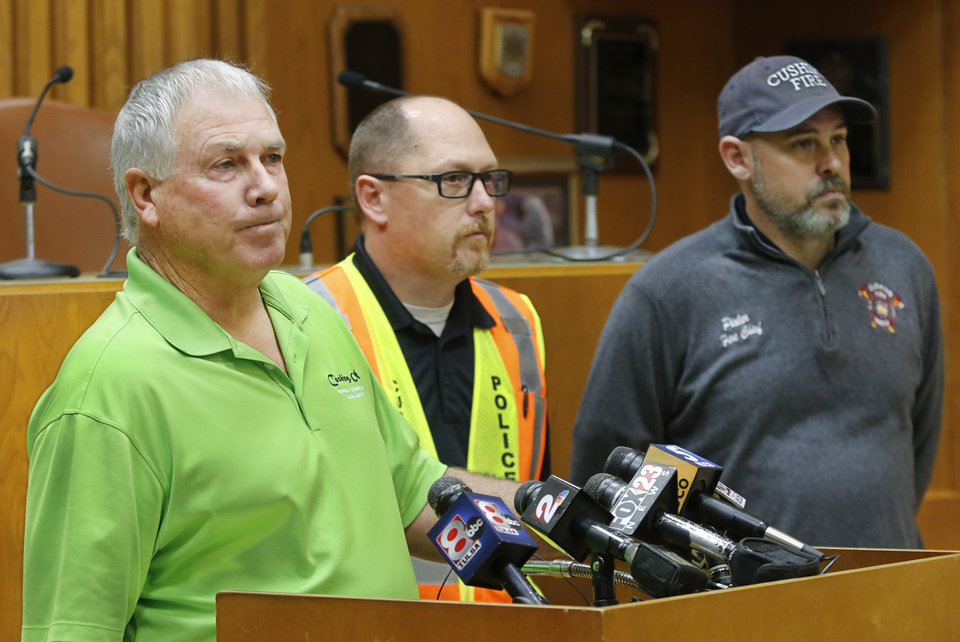 Photo - City officials provide damage updates to the media at a morning briefing at city hall. From left, City Manager Steve Spears, Police Chief Tully Folden and Fire Chief Chris Pixler. Damage in downtown Cushing on Monday, Nov. 7, 2016, caused by Sunday night's 5.0 magnitude earthquake. Photo by Jim Beckel, The Oklahoman
