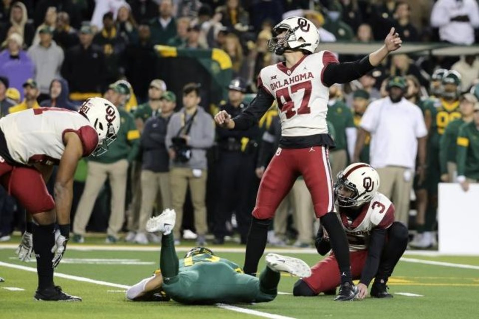 Photo -  Oklahoma place kicker Gabe Brkic (47) follows through on his go-ahead and eventual game-winning field goal against Baylor on Saturday. [AP Photo/Ray Carlin]