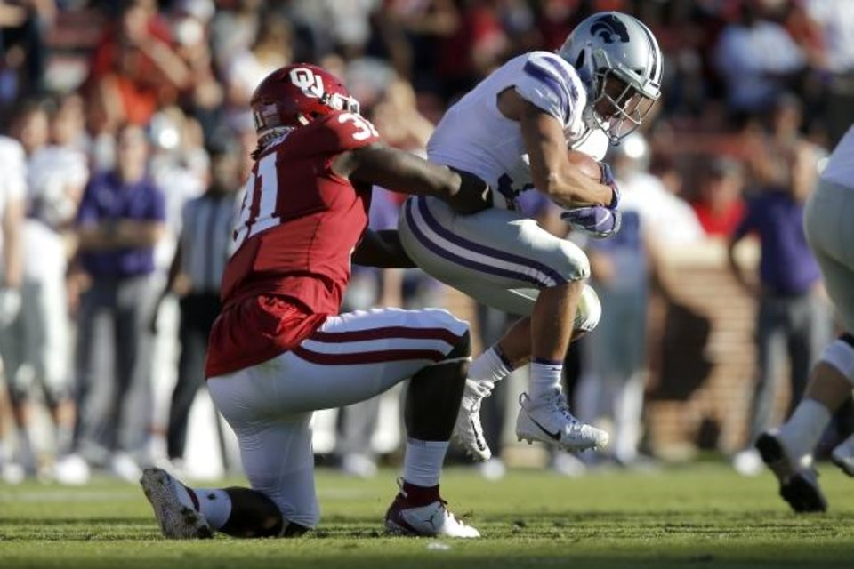 Photo -  Oklahoma's Jalen Redmond (31) tackles Kansas State's Dalvin Warmack during the Sooners' 51-14 win last season in Norman. [Bryan Terry/The Oklahoman]